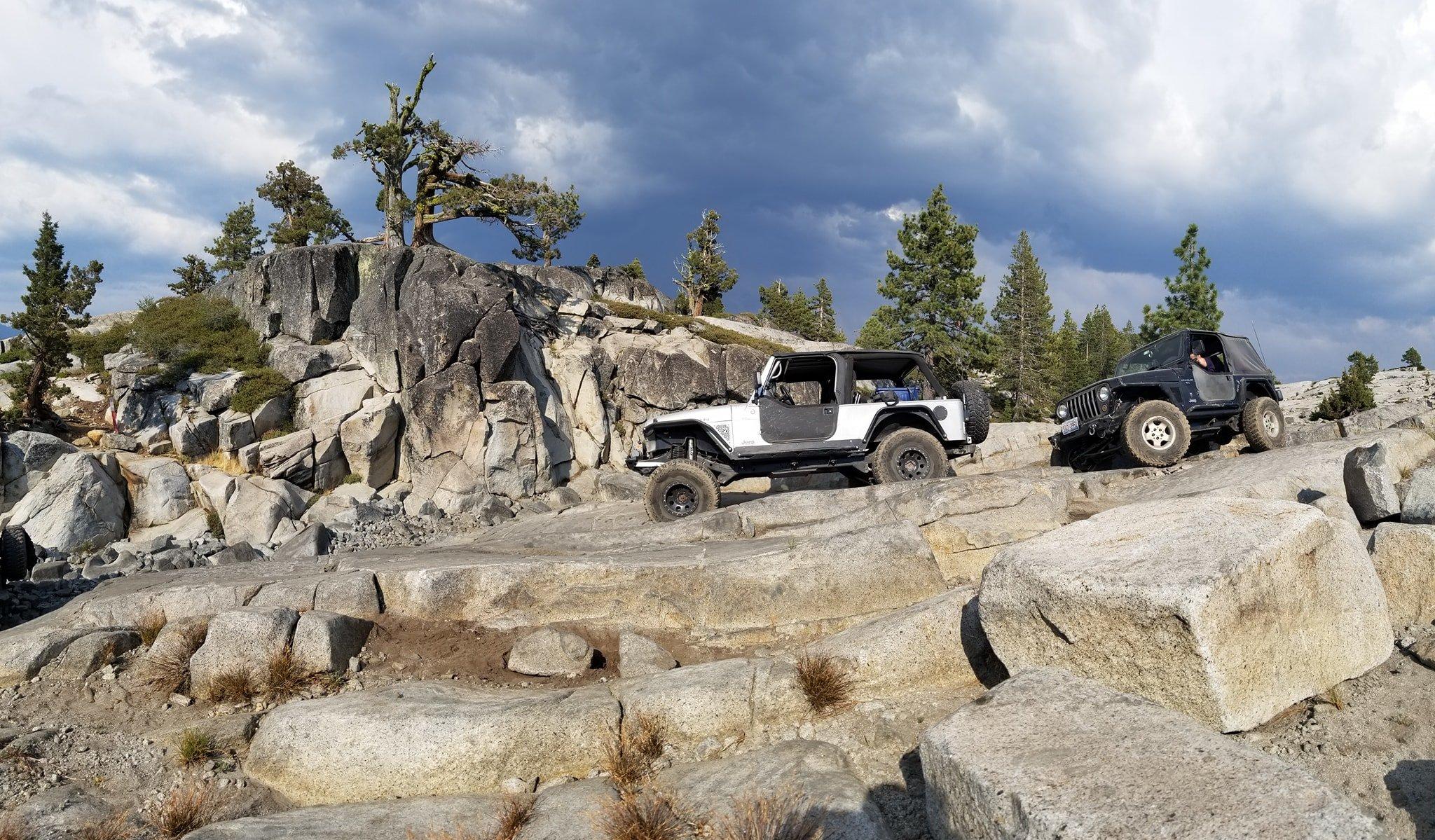 TJ and LJ navigating large rocks on the Rubicon Trail